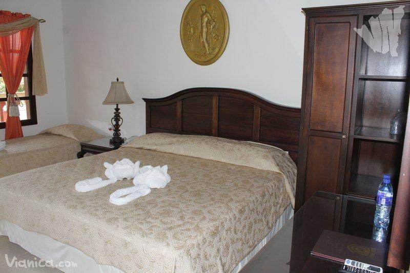 Habitaci n doble hotel palacio real nicaragua for Cama unipersonal